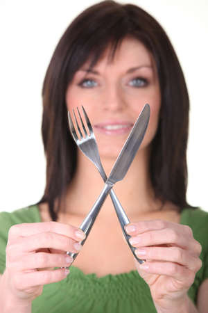 woman knife: Woman showing knife and fork