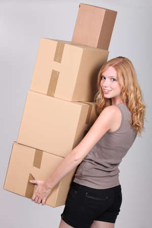 moving box: young woman holding cardboxes