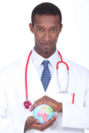 Doctor holding a globe photo