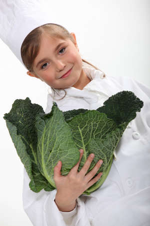 Girl carrying a cabbage head photo