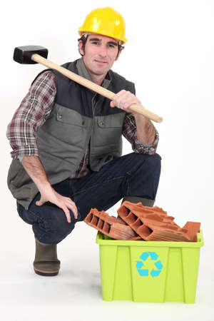 Man with recyclable rubbish photo