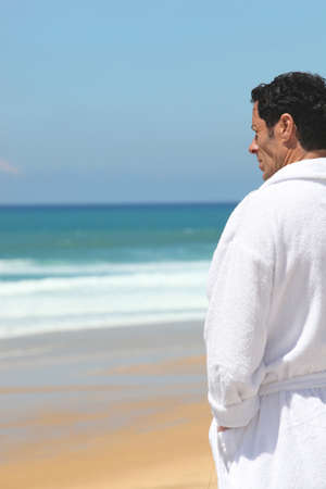 bath robes: Man standing by the sea