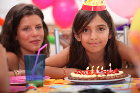 Girl celebrating her fifth birthday Stock Photo - 11039311