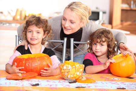Family carving pumpkins together Stock Photo - 11065041