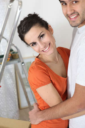 Attractive couple moving into new home photo