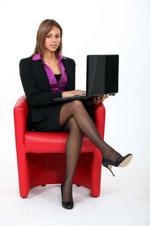 business woman legs: Businesswoman looking at her laptop Stock Photo
