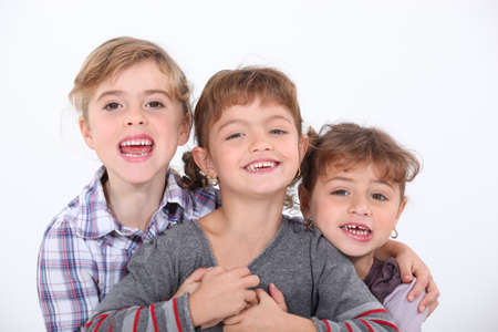 brothers and sisters: Studio portrait of three young siblings Stock Photo