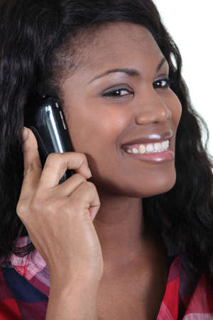 Woman talking on a mobile phone photo