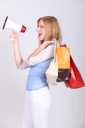 Woman announcing shopping deals photo