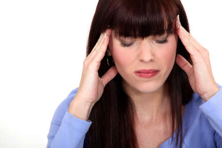 splitting headache: portrait of young woman having headache
