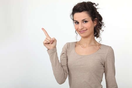 donna pensiero: Donna che punta il dito Archivio Fotografico