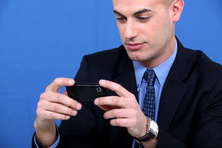 Businessman sending text message Stock Photo - 11717731