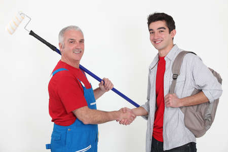 Painter and young man shaking hands photo