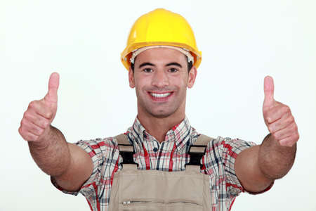 Tradesman giving two thumb