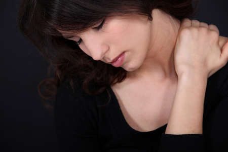 Woman suffering from neck pain photo