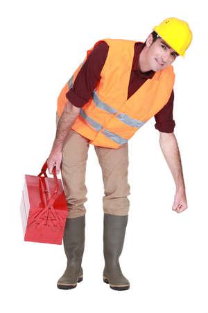 Trabajador de la construcci�n levantar algo pesado Foto de archivo - 11717640