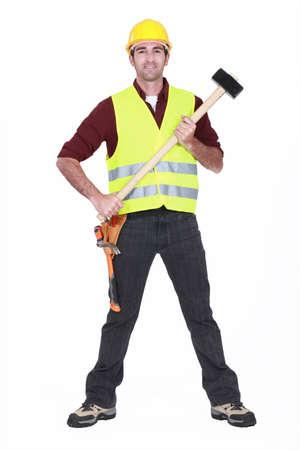 full-body portrait of carpenter holding hammer photo