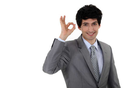 Businessman giving the a-ok sign Stock Photo - 11717706
