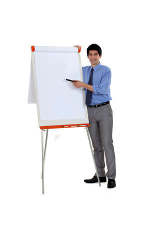 Man pointing at flip chart with pen photo
