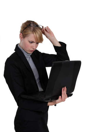 skivvy: Woman frowning at her laptop