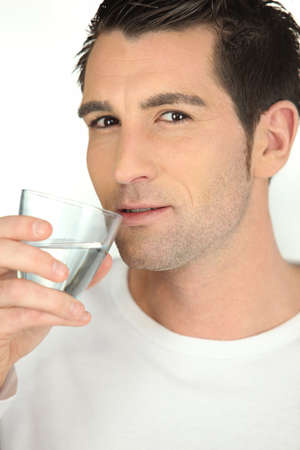 hair do: Man drinking a glass of water