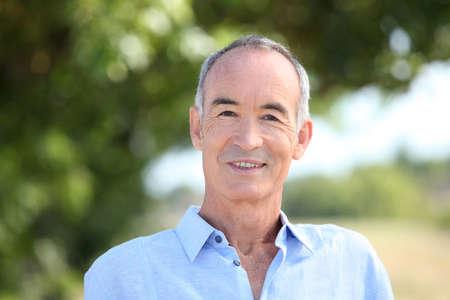 portrait of a senior man outdoors photo