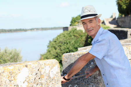 ramparts: Man on the ramparts overlooking the river Stock Photo