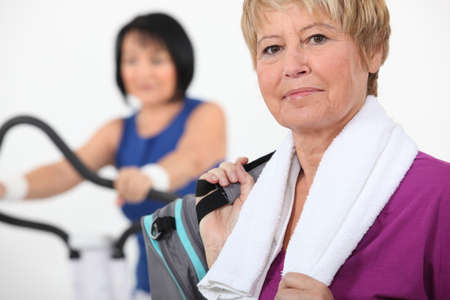 Mature women using gym equipment photo