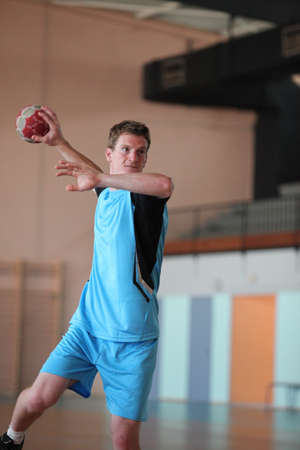 handball player in action photo