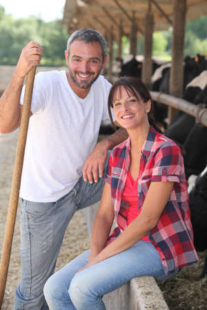 trough: Portrait of a farmer and his wife Stock Photo