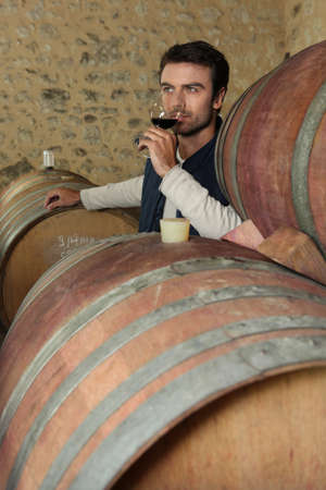 Man tasting wine in a cellar photo