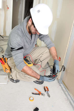 electrician tools: Electrician on construction site