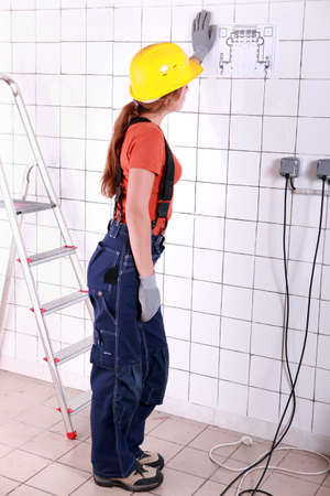 verifying: back view of an electrician