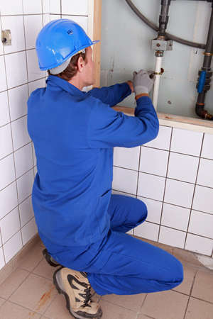 water pipes: Plumber repairing water pipes