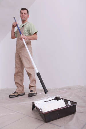 worker painting with a roller Stock Photo - 11116008
