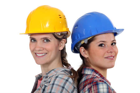 male dominated: Tradeswomen standing back to back