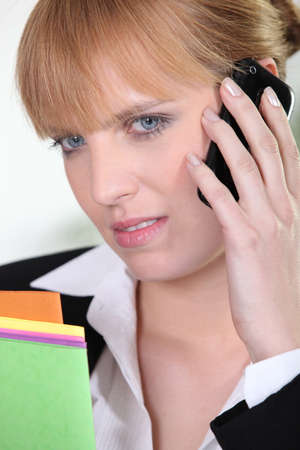 annoy: Unhappy woman talking on phone