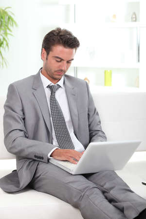 good looking woman: Businessman using a laptop