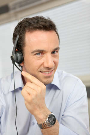 Man using a telephone headset photo