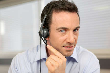 blue eyed: male telemarketer at work
