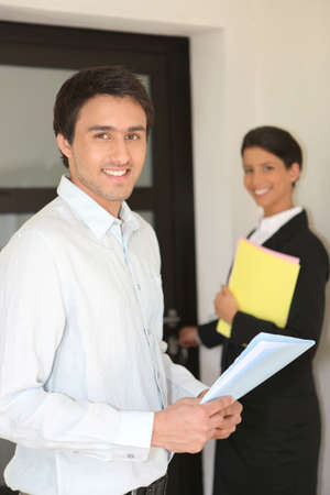 Real-estate agents visiting house photo