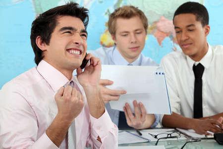 boastful: Young businessman rejoicing