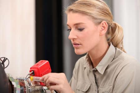 female technician working on an electronic circuit photo