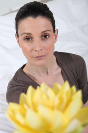 Woman with lotus flowers photo