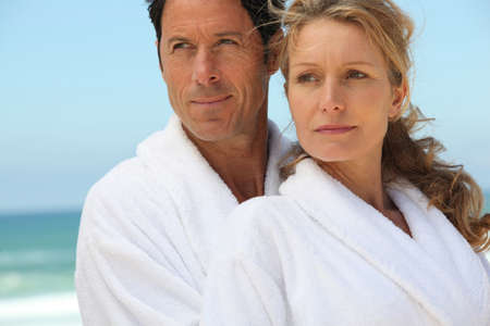 bath gown: Couple enjoying relaxing break at the seaside