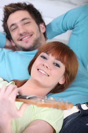 young man and woman having fun and relaxing photo