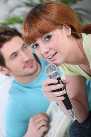 Couple singing karaoke photo