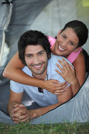 dark haired: portrait of a couple in a tent