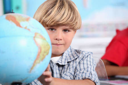 country boy: Kid learning geography. Stock Photo