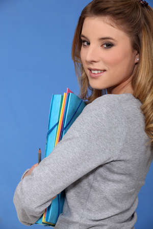 Young woman carrying folders photo